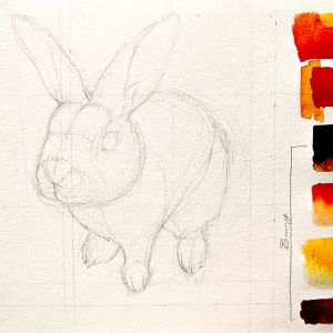 Sketch of a bunny on watercolor paper with paint swatches to the right in ochres, reds and browns.